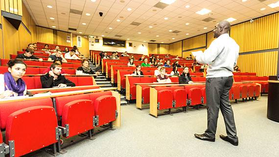 Academic giving a talk in lecture theatre